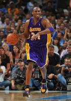 Kobe Bryant shows his teeth as he brings the ball up